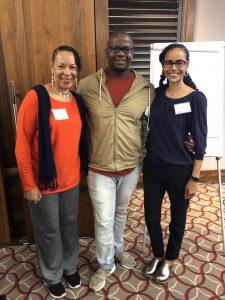 Dr. Cheryl Grills, Kagiso Nkosi, and Nkem Ndefo standing together smiling